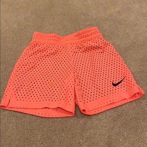 Fluorescent orange girls Nike shorts